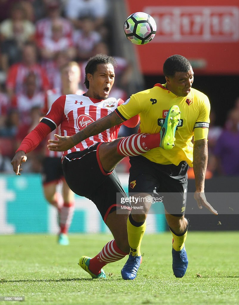 Virgil van Dijk of Southampton fouls Troy Deeney of Watford during the Premier League match between Southampton and Watford at St Mary's Stadium on August 13, 2016 in Southampton, England.