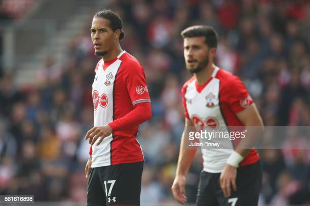 Virgil van Dijk of Southampton looks on alongside team mate Shane Long during the Premier League match between Southampton and Newcastle United at St...