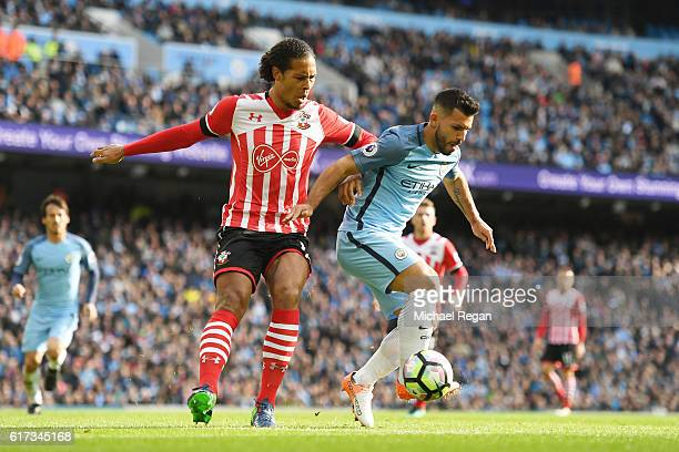 Virgil van Dijk of Southampton puts pressure on Sergio Aguero of Manchester City during the Premier League match between Manchester City and...