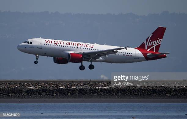 Virgin America plane lands at San Francisco International Airport on March 29 2016 in Burlingame California JetBlue Airways and Alaska Air Group are...