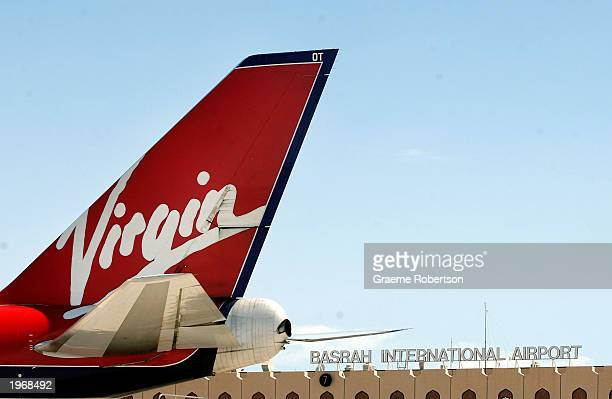 Virgin Atlantic aircraft sits at a gate at the Basrah International Airport May 2 2003 in Basrah Iraq The Virgin Atlantic 747400 was the first...