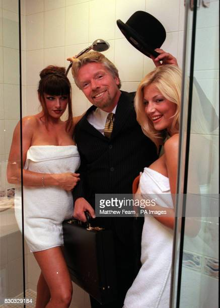 Virgin Atlantic Airways Chairman Richard Branson enjoys a shower with models Vanessa and Charlie in Virgin's new Revivals lounge at Heathrow Airport...