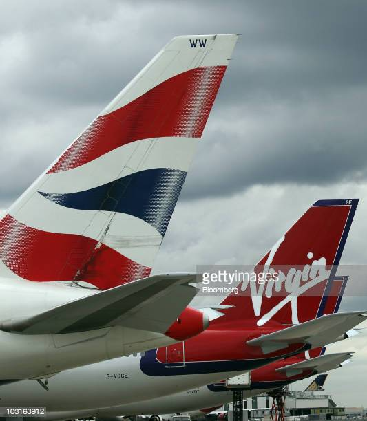 Virgin Atlantic and British Airways aircraft stand at Heathrow airport in London UK on Thursday July 29 2010 Virgin Atlantic Airways Ltd said...