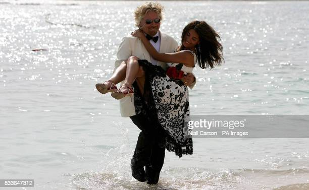 Virgin Atlantic boss Sir Richard Branson carries Italian actress Caterina Murino who plays Solange in the upcoming James Bond film Casino Royale...