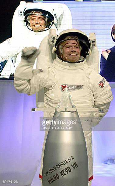 Virgin Atlantic Founder Richard Branson wearing a spacesuit arrives at the news conference to announce the winner of his Virgin Galatic SubOrbital...