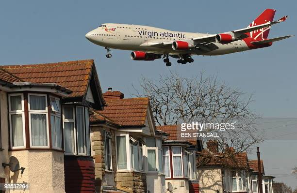 A Virgin Atlantic passenger jet flies over houses as it prepares to land at Heathrow Airport in west London on April 21 2010 Europe's airspace...