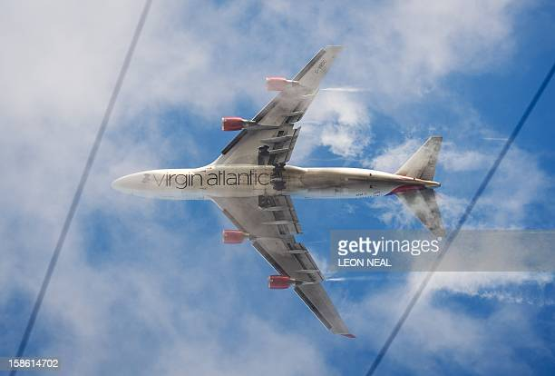 A Virgin Atlantic passenger plane comes into land at Heathrow airport in west London on December 21 2012 AFP PHOTO/LEON NEAL