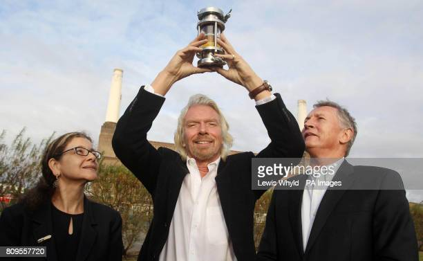 Virgin Atlantic President Sir Richard Branson holds a container of biofuel whilst flanked by Dr Jennifer Holmgren Chief Executive LanzaTech and Steve...