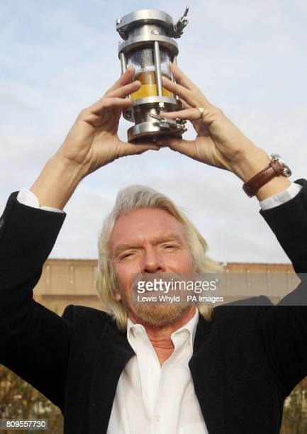 Virgin Atlantic President Sir Richard Branson holds a container of biofuel after a press conference at Battersea Power Station London where he...