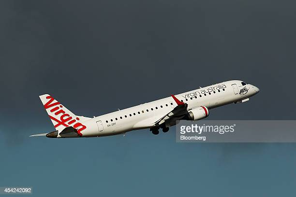 A Virgin Australia Holdings Ltd aircraft takes off at Sydney Airport in Sydney Australia on Wednesday Aug 27 2014 Virgin Australia the nation's...