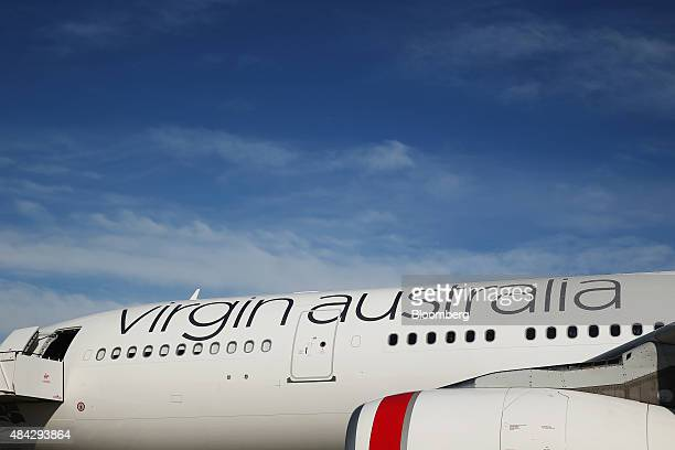Virgin Australia Holdings Ltd branding is displayed on the fuselage of an Airbus SAS A330 aircraft at Sydney Airport in Sydney Australia on Monday...