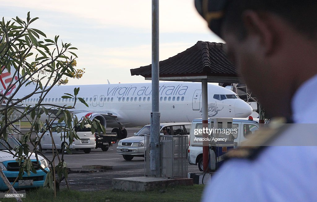 Virgin Australia plane is seen at International Ngurah Rai Airport in Bali, Indonesia on April 25, 2014. An Indonesian airport went on alert Friday as the air force announced that a plane approaching Ngurah Rai International in Bali had been hijacked in midair. Airline official Heru Sudjatmiko announced minutes later that an intoxicated passenger on the Virgin Australia flight from Brisbane had been arrested for creating a disturbance.