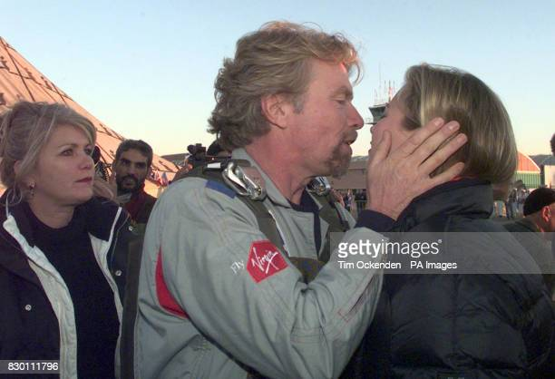 Virgin boss Richard Branson kisses his daughter Holly goodbye as his wife Joan looks on before setting off in his bid to circumnavigate the globe by...