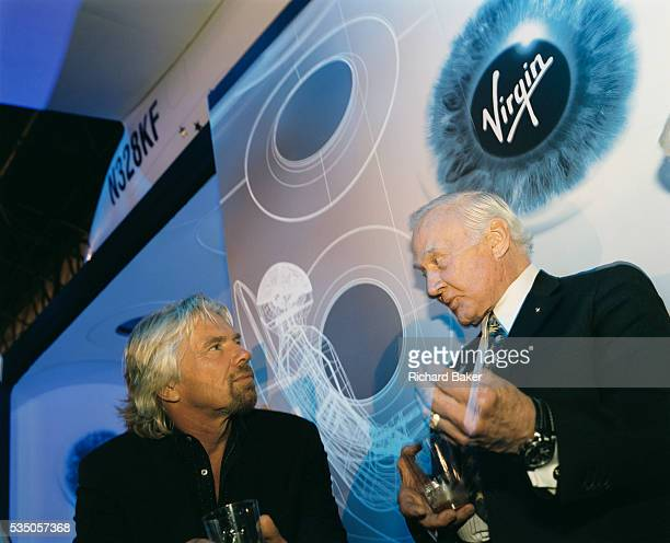 Virgin boss Sir Richard Branson and former Apollo astronaut Buzz Aldrin chat after Virgin Galactic's SpaceShipTwo's unveiling at the New York Wired...
