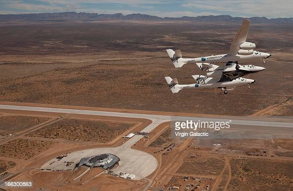 Virgin Galactic vehicles WhiteKnightTwo and SpaceshipTwo fly over Spaceport America for runway dedication event at Spaceport America on October 22...