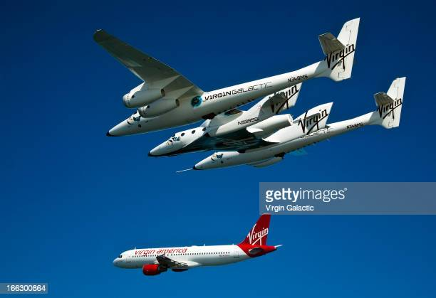 Virgin Galactic vehicles WhiteKnightTwo and SpaceShipTwo fly alongside Virgin America plane for the opening of the new Virgin America terminal at San...