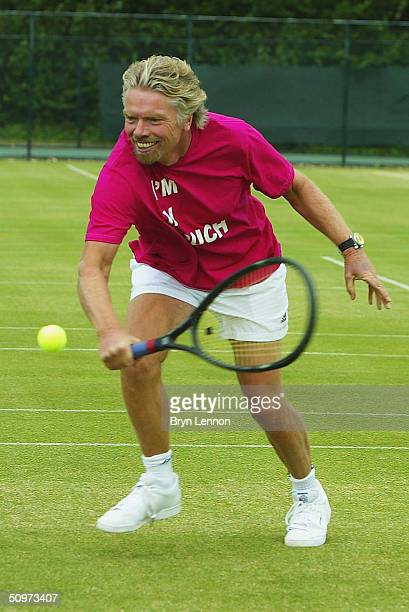 Virgin Group Chairman Richard Branson plays tennis during a photo call to promote the 2004 WTA 'Get In Touch With Your Feminine Side' Tour ad...