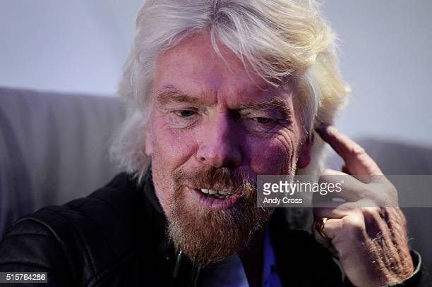 Virgin Group Founder Sir Richard Branson at Denver International Airport discussing the Virgin America's inaugural flight from San Francisco to...