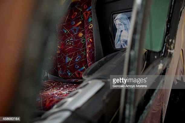 Virgin image is palced close to the driver seat inside the crashed bus in which 13 people died on November 9 2014 in Venta del Olivo at Murcia...