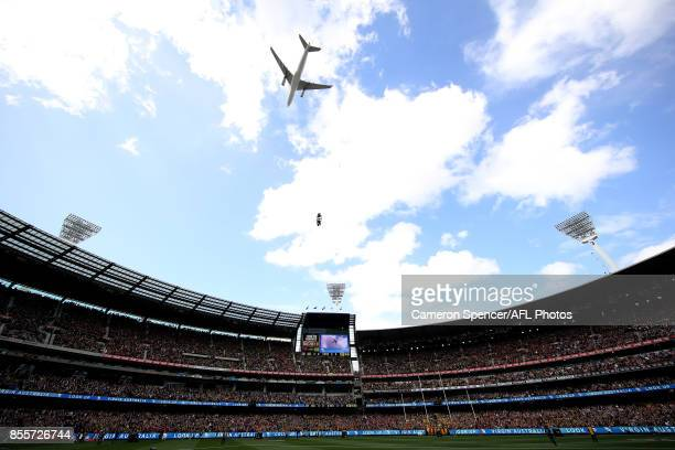 Virgin jet peforms a flyby during the 2017 AFL Grand Final match between the Adelaide Crows and the Richmond Tigers at Melbourne Cricket Ground on...