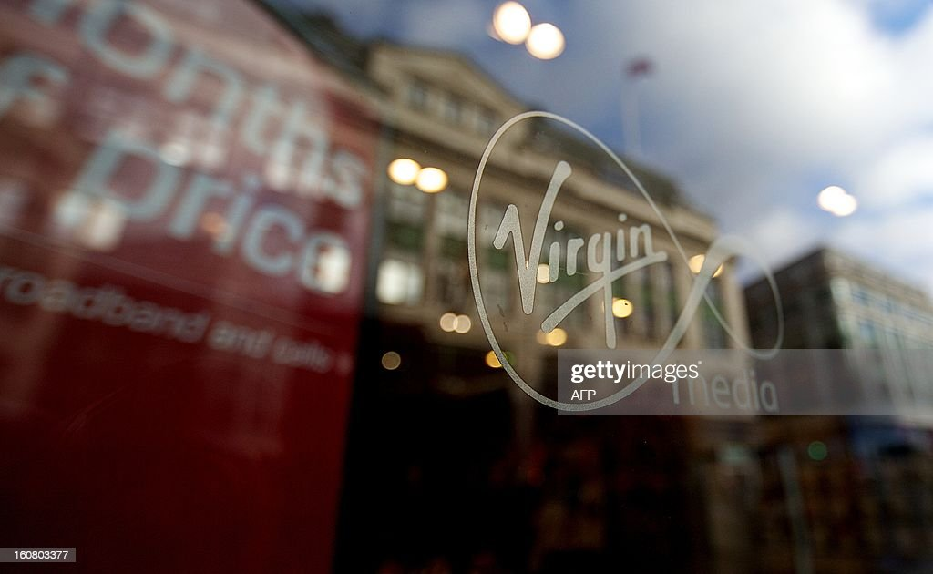 A Virgin Media logo is displayed in the window of the company's shop on Oxford Street in central London on February 6, 2013. US-based cable operator Liberty Global said late on February 5, 2013 that it will acquire Virgin Media in a stock and cash merger valued at USD $23.3 billion, eyeing key strategic markets in Europe. AFP PHOTO/ANDREW COWIE