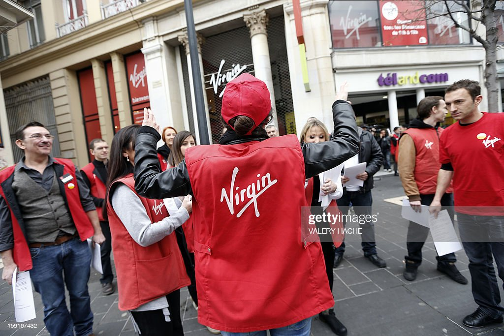 Virgin Megastore employees demonstrate against planned job cuts at the entrance of the store on January 9, 2013, in Nice, southeastern France. Virgin's Megastore music and book unit, which is known in France as a 'culture' retailer, said it will file for insolvency on January 9, 2013. Originally started by Richard Branson, the British billionaire and chairman of the Virgin Group, the Virgin Megastores were bought by the French Lagardere group in 2001.