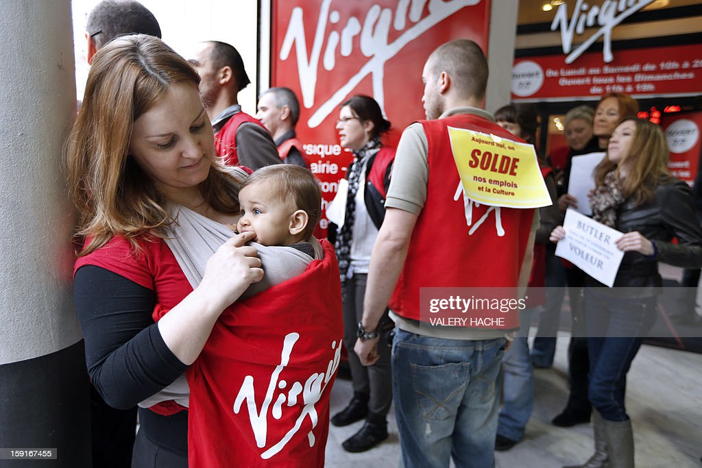 Virgin Megastore employees demonstrate against planned job cuts at the entrance of a Virgin Megastore on January 9, 2013 in Nice, southern France. Virgin's Megastore music and book unit, which is known in France as a 'culture' retailer, said it will file for insolvency on January 9, 2013. Originally started by Richard Branson, the British billionaire and chairman of the Virgin Group, the Virgin Megastores were bought by the French Lagardere group in 2001.