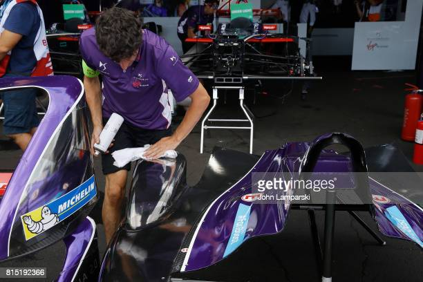 Virgin Racing spoilers and engine covers are being prepared in the pits during the Formula E Qualcomm New York City ePrix on July 15 2017 in New York...