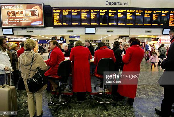 Virgin Rail employees handle queries from passengers stuck at Euston Station due to overrunning engineering work on January 3 2008 in London England...