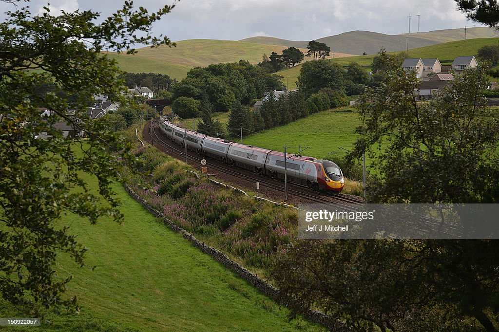 A Virgin train passes along the West Coast mainline route near Abington on August 29, 2012 in Scotland. Earlier this month Virgin lost out to First Group in their bid to run a 13 year West Coast franchise starting in December and are now starting a legal challenge to try and maintain the service it has operated for the past 15 years.