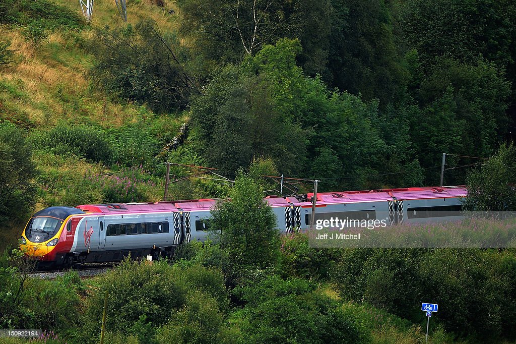 A Virgin train passes along the West Coast mainline route near Abington on August 29, 2012 in Scotland. Earlier this month Virgin lost out to First Group in their bid to run a 13 year West Coast franchise starting in December and are now starting a legal challenge to try and maintain the service it has operated for the past 15 years