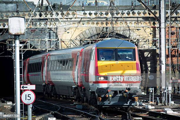 A Virgin Trains East Coast train operated by Virgin Trains is seen leaving King Cross station as it begins full operations from London UK on Monday...