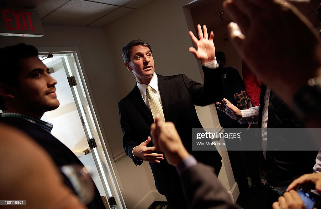 Virginia Attorney General Ken Cuccinelli, the Republican candidate for Governor of Virginia, greets supporters after speaking at a 'Get out the Vote' rally October 28, 2013 in Fairfax, Virginia. Cuccinelli is running against Democratic candidate Terry McAullife in a very close race.