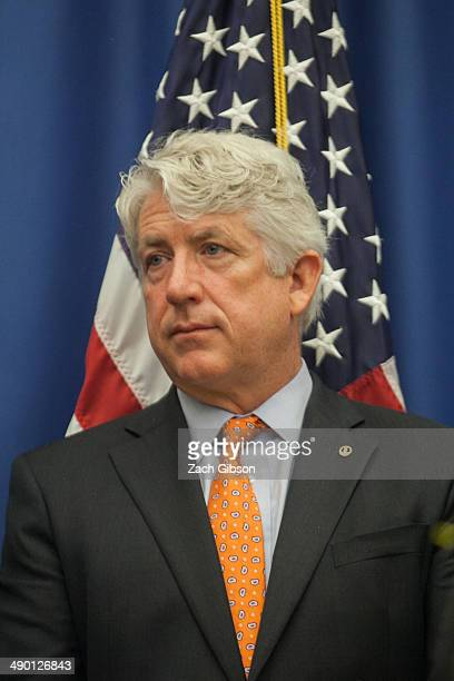 Virginia Attorney General Mark Herring listens to questions after a press conference after a court hearing May 13 2014 in Richmond Virginia Three...
