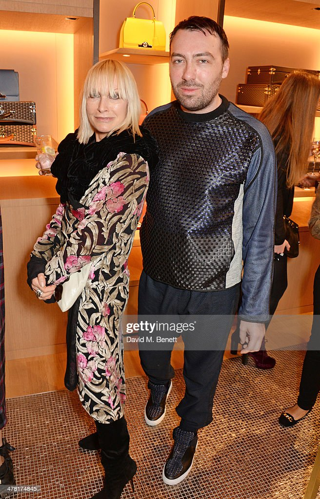 Virginia Bates (L) and James Long attend the Moynat London boutique opening on March 12, 2014 in London, England.