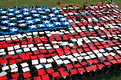 Virginia Beach, Virginia, September 11, 2006 - More than 1,200 service members, civic leaders, and civilians banned together to create a human flag during the 9/11 Hampton Roads Remembers ceremony at Mount Trashmore Park.