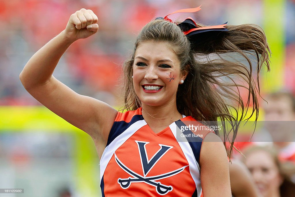 A Virginia Cavaliers cheerleader gestures against the Richmond Spiders at Scott Stadium on September 1, 2012 in Charlottesville, Virginia.