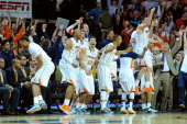 Virginia Cavaliers players celebrate against the Syracuse Orange during the second half at John Paul Jones Arena on March 1 2014 in Charlottesville...