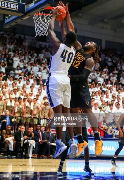 Virginia Commonwealth Rams forward Mo AlieCox blocks a shot by George Washington Colonials forward Kevin Marfo during an Atlantic 10 men's basketball...