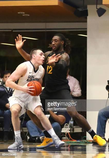 Virginia Commonwealth Rams forward Mo AlieCox blocks George Washington Colonials forward Tyler Cavanaugh during an Atlantic 10 men's basketball game...