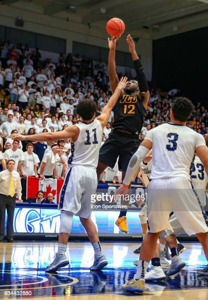 Virginia Commonwealth Rams forward Mo AlieCox shoots over George Washington Colonials forward Arnaldo Toro during an Atlantic 10 men's basketball...