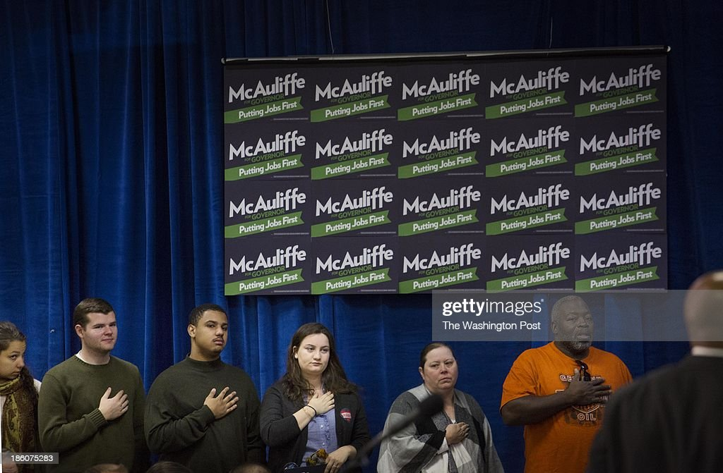 Virginia constituents pledge allegiance before Virginia gubernatorial candidate Terry McAuliffe and President Bill Clinton arrive to an event in Dale City, Virginia on Sunday October 27, 2013.