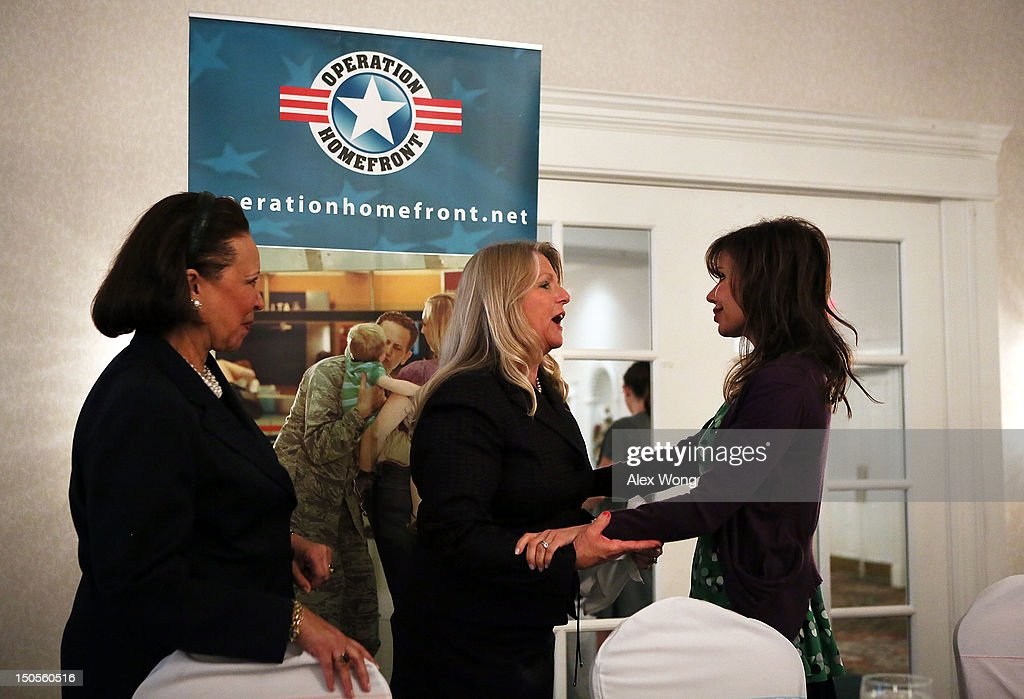 Virginia first lady Maureen McDonnell (2nd L) greets 'What to Expect' book series author Heidi Murkoff (R) as Alma Powell (L), wife of former U.S. Secretary of State Gen. Colin Powell, looks on during a 'What to Expect' baby shower August 21, 2012 in Springfield, Virginia. The DC Metro Chapter of Operation Homefront held the event, with parenting and pregnancy workshops, to celebrate with 100 new and expecting military mothers representing each branch of service from DC, Maryland and Northern Virginia.