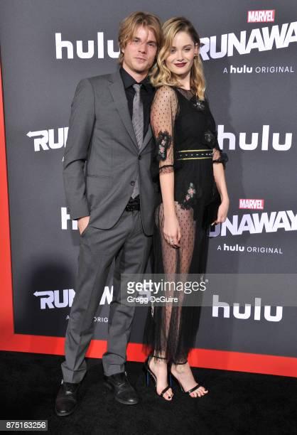Virginia Gardner and Graham Rogers arrive at the premiere of Hulu's 'Marvel's Runaways' at Regency Bruin Theatre on November 16 2017 in Los Angeles...