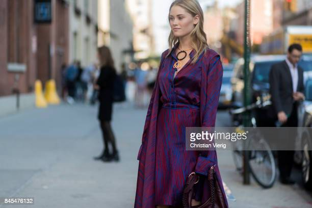 Virginia Gardner wearing a purple dress seen in the streets of Manhattan outside Diane von Furstenberg during New York Fashion Week on September 10...