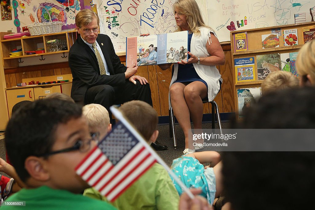 Virginia Gov. Bob McDonnell (L) and his wife Maureen McDonnell read a book to students at the KinderCare Learning Center August 9, 2012 in Alexandria, Virginia. A 21-year veteran of the U.S. Army, Gov. McDonnell's visit to the center is part of KinderCare's Honoring the Troops program taking place at the end of August in Virginia and Maryland.