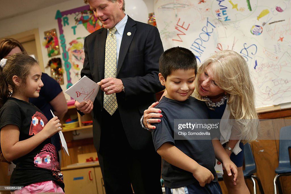 Virginia Gov. Bob McDonnell (C) and his wife Maureen McDonnell (R) receive handmade cards from students at the KinderCare Learning Center August 9, 2012 in Alexandria, Virginia. A 21-year veteran of the U.S. Army, Gov. McDonnell's visit to the center is part of KinderCare's Honoring the Troops program taking place at the end of August in Virginia and Maryland.