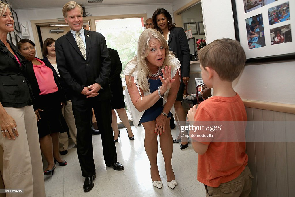 Virginia Gov. Bob McDonnell (C) and his wife Maureen McDonnell (3rd R) say hello to a young student while visiting the KinderCare Learning Center August 9, 2012 in Alexandria, Virginia. A 21-year veteran of the U.S. Army, Gov. McDonnell's visit to the center is part of KinderCare's Honoring the Troops program taking place at the end of August in Virginia and Maryland.