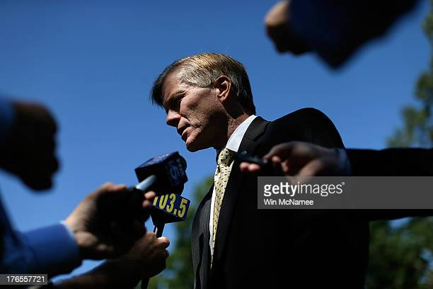 Virginia Gov Bob McDonnell answers questions following a battleground preservation announcement at Ball's Bluff State Park August 15 2013 in Leesburg...