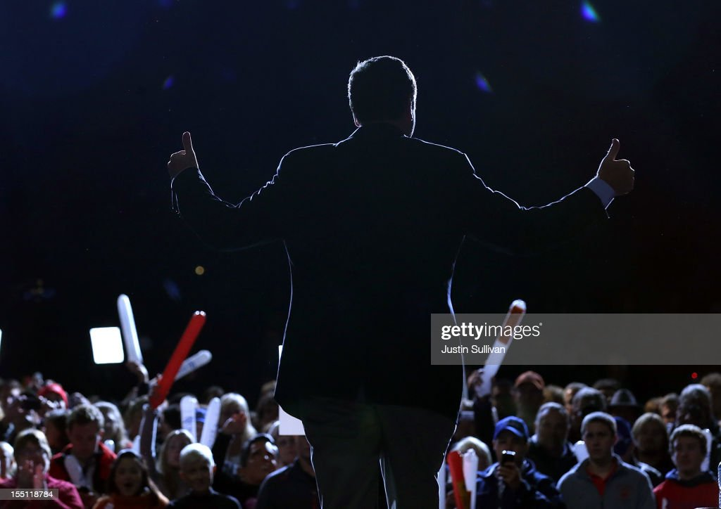 Virginia Gov. <a gi-track='captionPersonalityLinkClicked' href=/galleries/search?phrase=Bob+McDonnell&family=editorial&specificpeople=6369061 ng-click='$event.stopPropagation()'>Bob McDonnell</a> greets the crowd during a campaign rally for Republican presidential candidate, former Massachusetts Gov. Mitt Romney at Farm Bureau Live on November 1, 2012 in Virginia Beach, Virginia. With less than one week to go until election day, Mitt Romney is campaigning in Virginia.